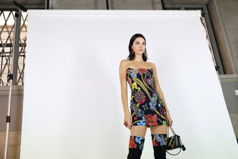 Fashion model, Clothing, Fashion, Shoulder, Dress, Fashion design, Yellow, Fashion show, Model, Street fashion,