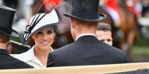 Hat, Tradition, Headgear, Event, Fedora, Dress, Gesture, Fashion accessory, Uniform, Horse,
