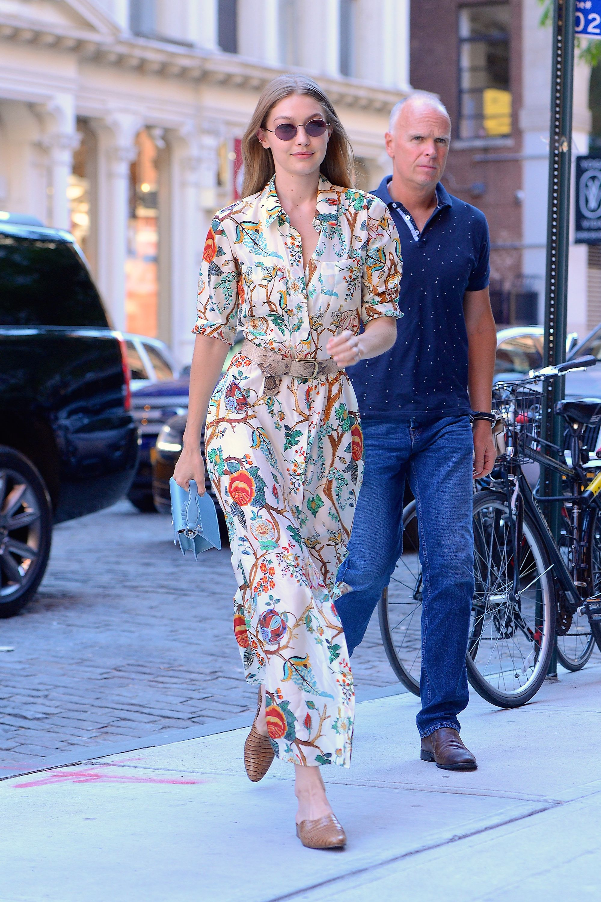 June 19, 2018 The model looked summer-ready in NYC with a floral dress by Alberta Ferretti. She complemented the look with croc-embossed mules from Freda Salvador, a Paula Cademartori bag, a Streets Ahead belt, and Oliver Peoples sunglasses.