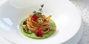 whole spahgetti with dried tomatoes and green beans sauce restaurant dish