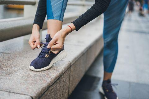Runner tying her shoelaces