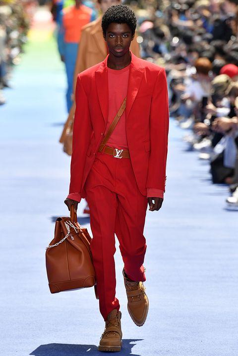 Fashion, Runway, Clothing, Street fashion, Red, Fashion model, Fashion show, Orange, Suit, Human,
