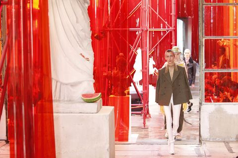Red, Curtain, Interior design, Fashion, Textile, Display window, Window, Window treatment, Theatrical scenery, Stage,