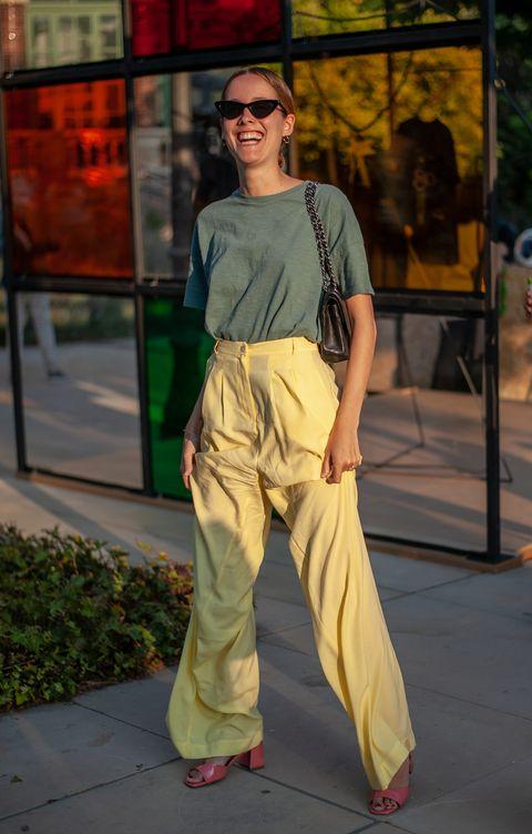 Clothing, Fashion, Yellow, Street fashion, Snapshot, Trousers, Leg, Fashion design, Photography, Fashion model,