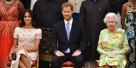 Meghan Markle with Prince Harry and Queen Elizabeth
