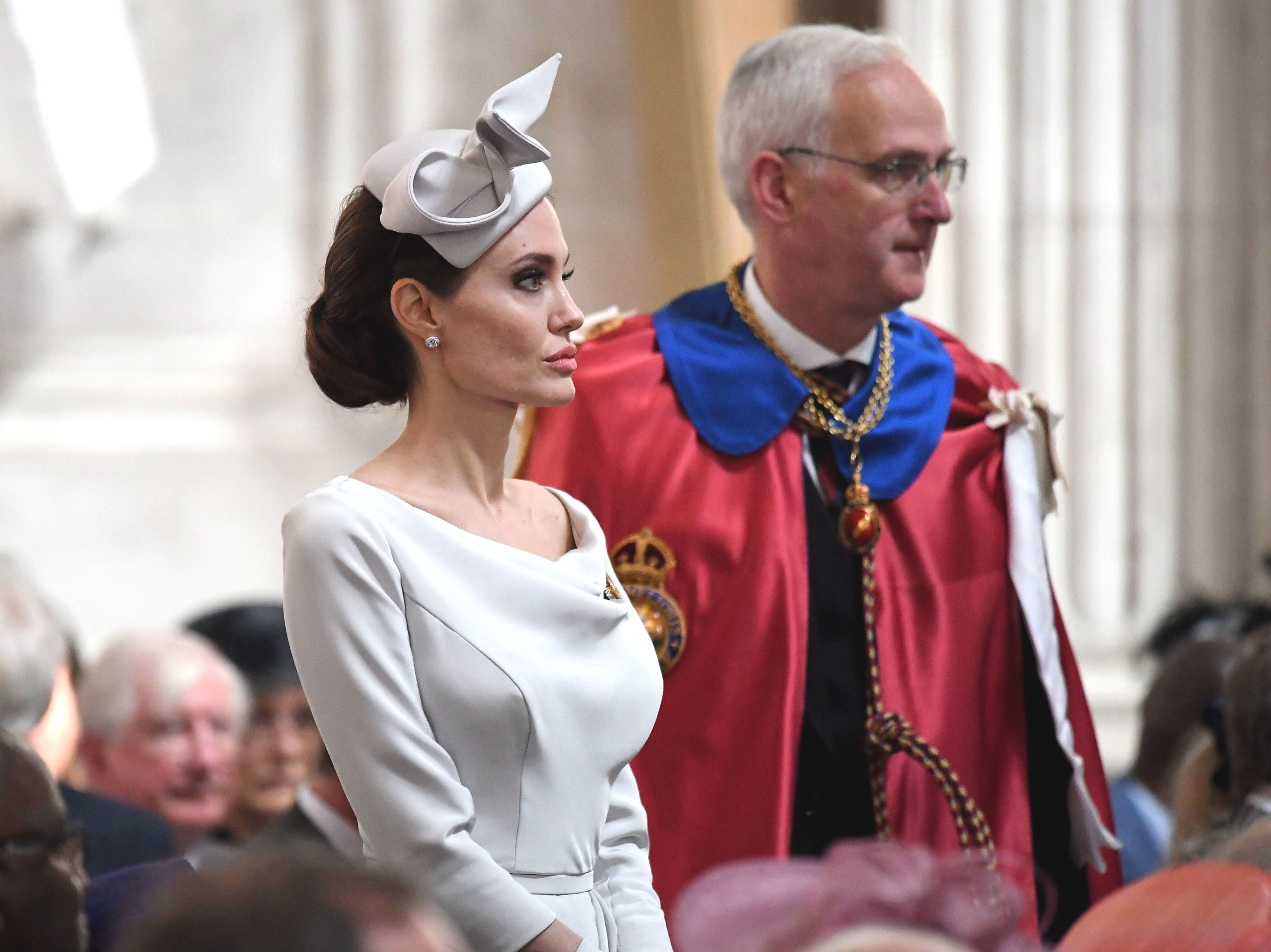 Angelina Jolie Gets Emotional at London War Memorial in Behind-the-Scenes Photos from Her Royal Event