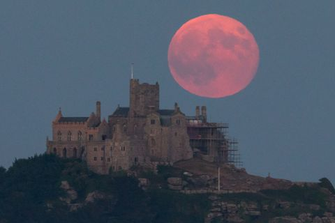 marazion, england june 28 a full moon rises behind st michaels mount in marazion near penzance on june 28, 2018 in cornwall, england tonights strawberry moon, a name given to the full moon in june by native americans because it coincides with strawberry picking season, comes as parts of the uk continue to experience heatwave weather and record breaking temperatures photo by matt cardygetty images