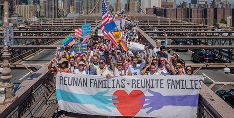 People, Crowd, Metropolitan area, Protest, Daytime, Landmark, Urban area, City, Architecture, Public event,