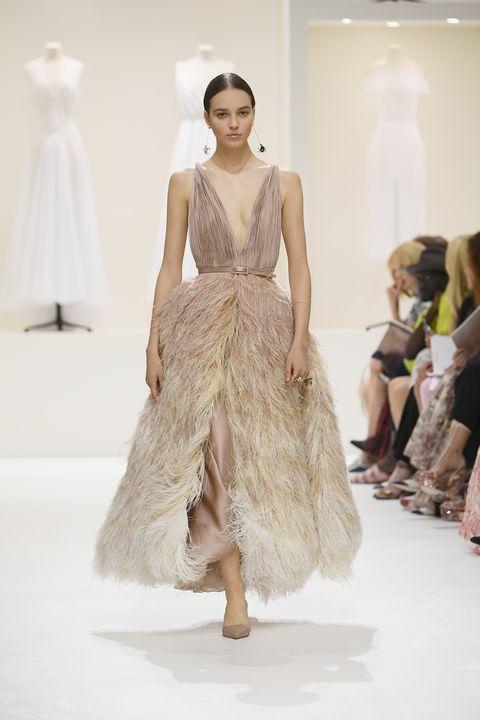 Fashion model, Fashion show, Fashion, Clothing, Runway, Dress, Haute couture, Shoulder, Gown, Waist,
