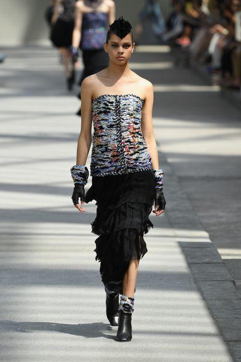 Fashion model, Fashion, Fashion show, Runway, Shoulder, Clothing, Street fashion, Waist, Haute couture, Dress,