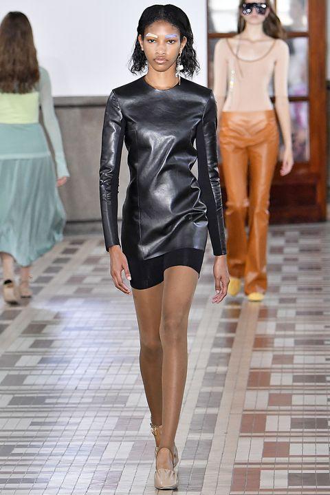Fashion model, Fashion, Fashion show, Clothing, Runway, Leather, Shoulder, Haute couture, Leg, Fashion design,
