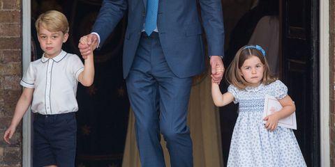 Standing, Suit, Formal wear, Event, Outerwear, Child, Tie, Vacation, Tuxedo, Dress shirt,