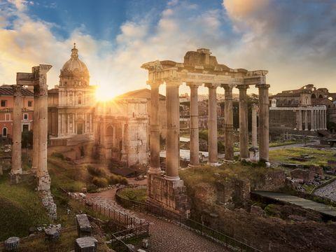 Temple of Vespasian and Titus and Church of Santi Luca e Martina at Forum Romanum at sunrise, Rome, Lazio, Italy
