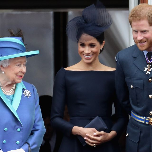 london, england   july 10  l r  queen elizabeth ii, meghan, duchess of sussex, prince harry, duke of sussex watch the raf flypast on the balcony of buckingham palace, as members of the royal family attend events to mark the centenary of the raf on july 10, 2018 in london, england  photo by chris jacksongetty images