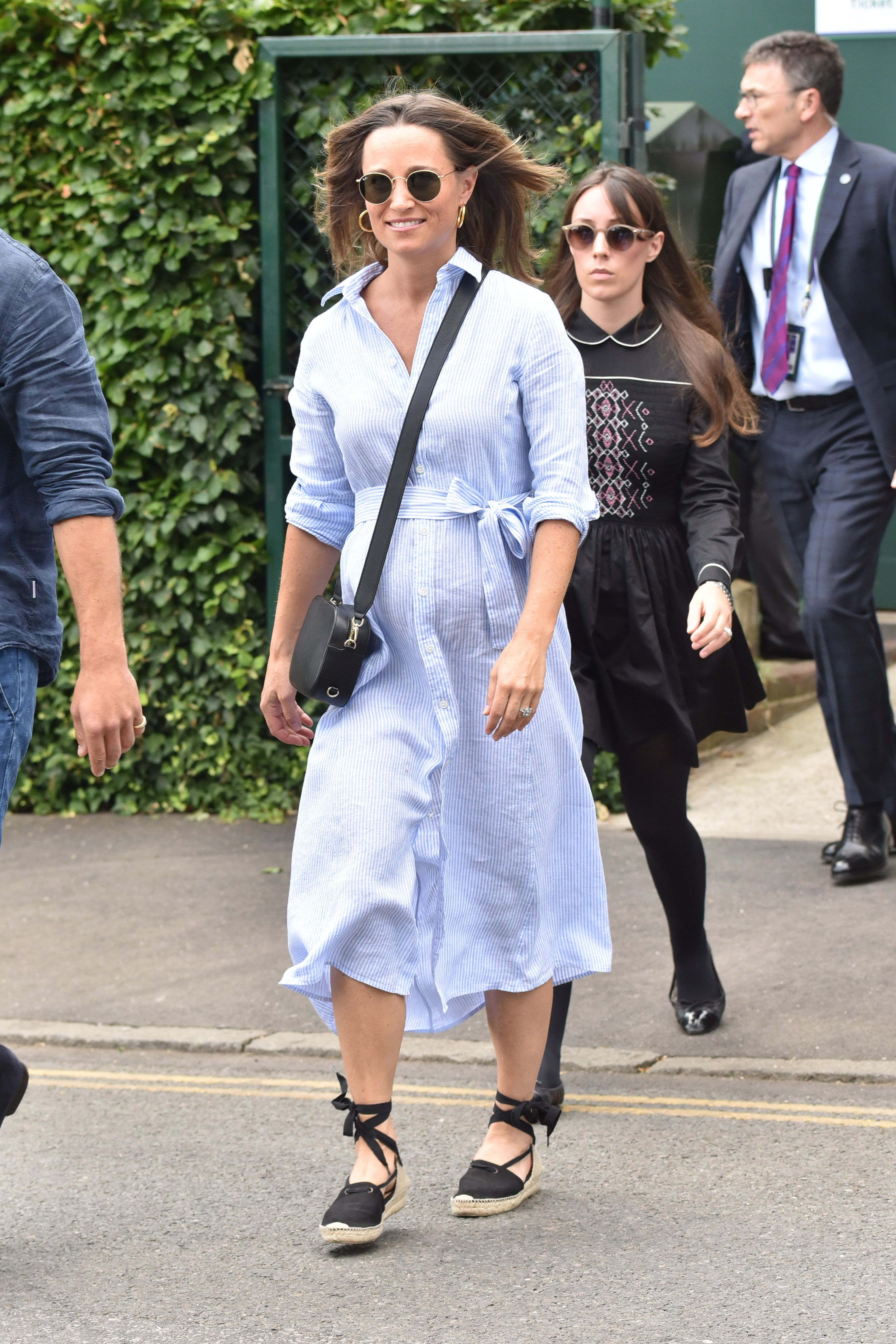 Pippa attended day nine of Wimbledon while wearing a blue striped shirt dress, Castañer espadrille wedges, and her black Pop and Suki camera bag.