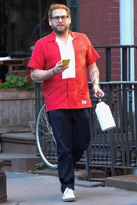 Red, Street fashion, Glasses, Street, Recreation, Trousers, Walking, Jeans, Jacket, Sportswear,