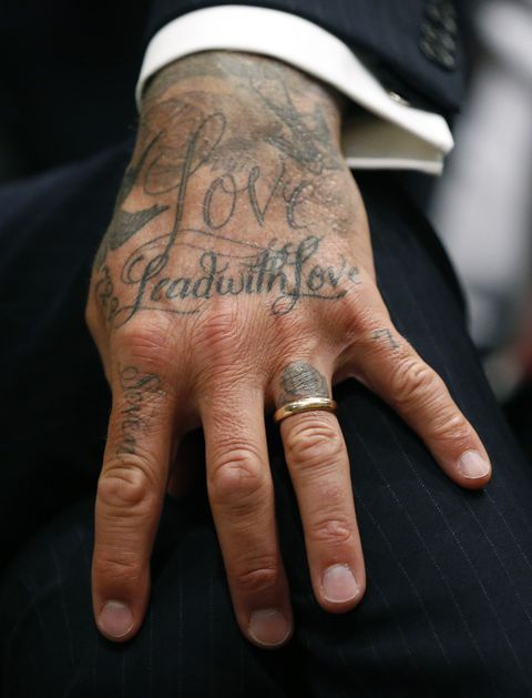 english retired professional footballer david beckhams tattooed hand is pictured as he attends a city of miami commissioners meeting where he and his partners presented plans to build a major league soccer stadium on public land in miami, florida, on july 12, 2018   beckham and his partners will present stadium and park plans to city of miami commissioners photo by rhona wise  afp        photo credit should read rhona wiseafp via getty images