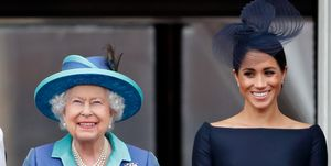 Meghan Markle stands next to Queen Elizabeth