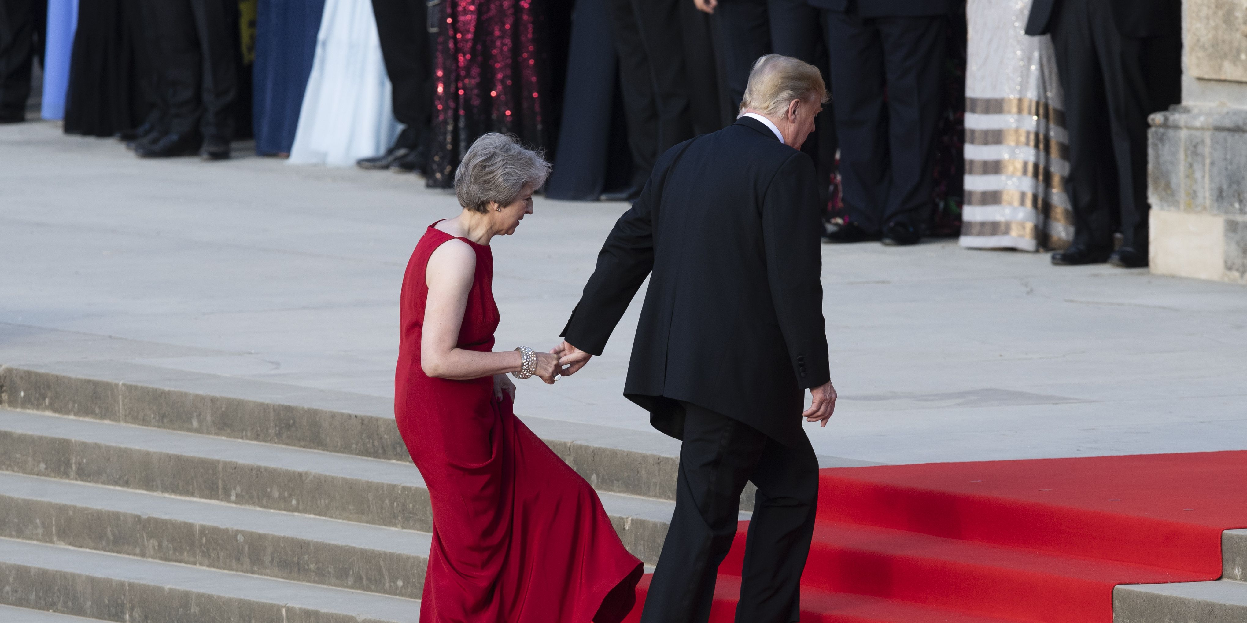 Donald Trump tried held Theresa May's hand again and it's painfully awkward