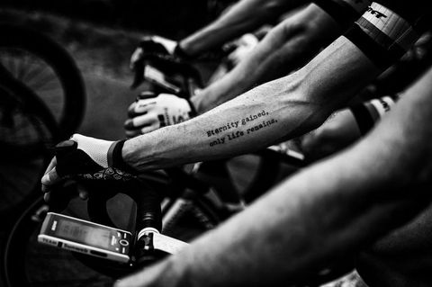 a tattoo on usas chad hagas forearm is pictured as he rides in the pack during the seventh stage of the 105th edition of the tour de france cycling race between fougeres and chartres, western france, on july 13, 2018 photo by marco bertorello  afp  black and white version        photo credit should read marco bertorelloafp via getty images