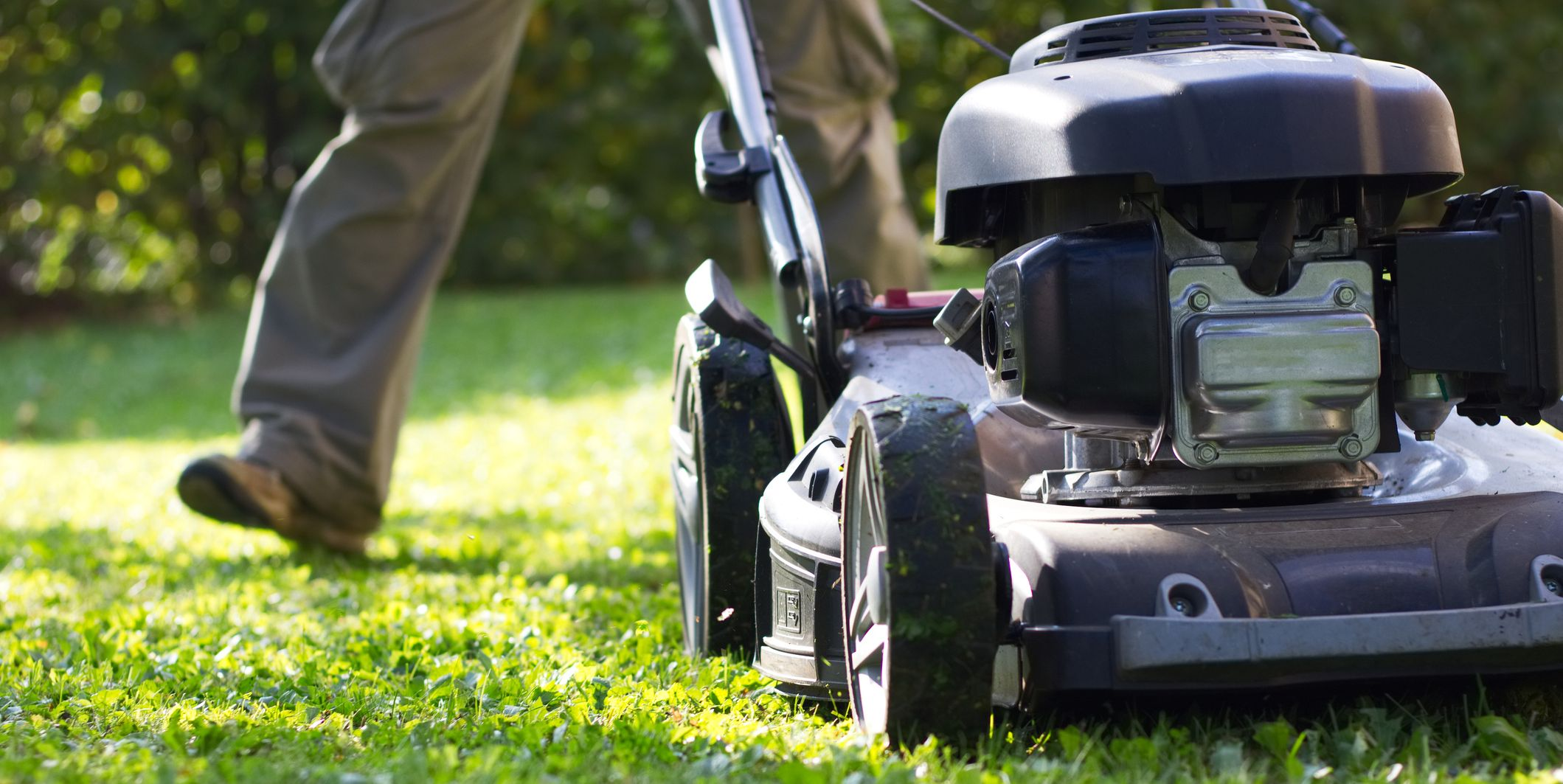 lawn mower during the mowing grass in garden