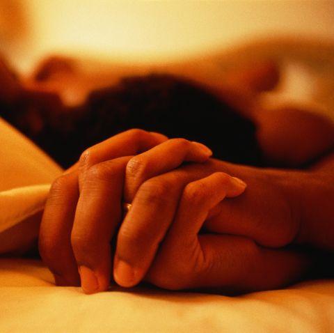 COUPLE'S HANDS.