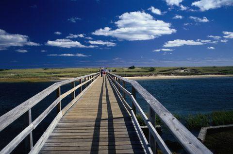 Sky, Boardwalk, Horizon, Natural landscape, Water, Walkway, Bridge, Road, Cloud, Guard rail,