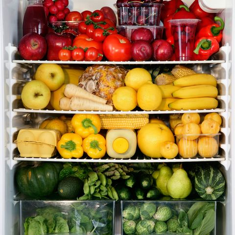 Fidge filled up with vegetables and fruit sorted by colour