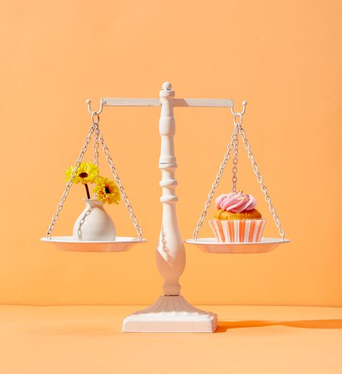 scale with cupcake and flowers