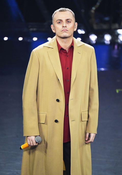 Clothing, Fashion, Overcoat, Outerwear, Coat, Yellow, Trench coat, Fashion design, Fashion show, Fashion model,