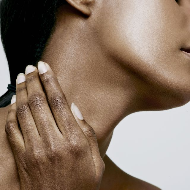 close up of woman holding neck, neck pain
