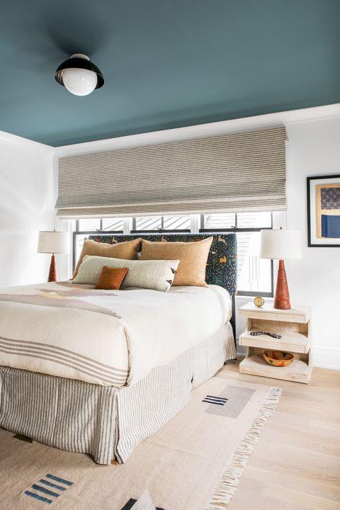bedroom with blue ceiling designed by cortney bishop design