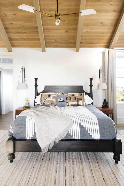 bedroom with wood ceiling designed by cortney bishop design
