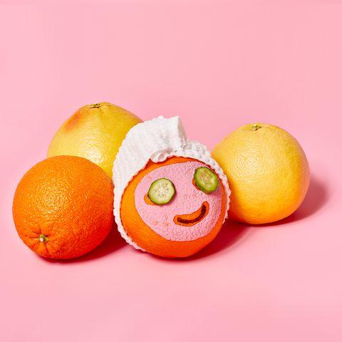 oranges with face masks