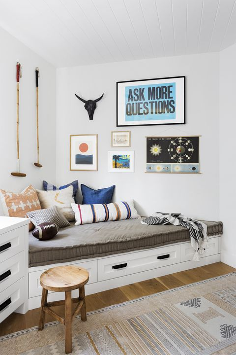 playroom with a daybed in the corner photo by amy bartlam design by kate lester interiors