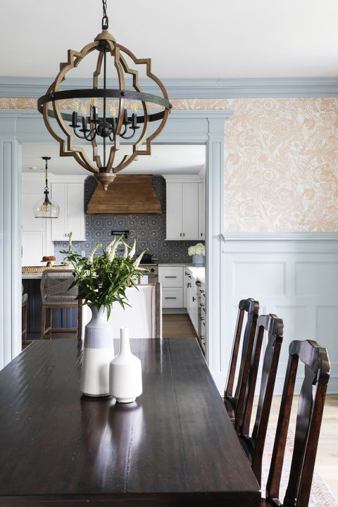 home featuring warm neutrals and soothing blue hues to accent the beautiful architecture of the vintage home interior designer karen b wolf dining room