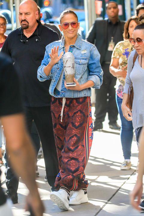 Clothing, People, Street fashion, Fashion, Eyewear, Jeans, Sunglasses, Denim, Hairstyle, Footwear,