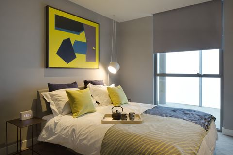 Bedroom, Bed, Room, Furniture, Interior design, Property, Yellow, Bed frame, Bed sheet, Bedding,