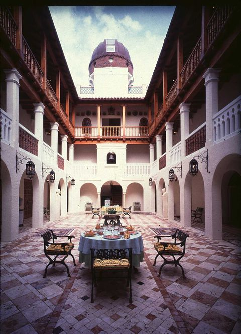 Courtyard, Building, Architecture, Arch, Room, Interior design, House, Estate, Symmetry, Furniture,
