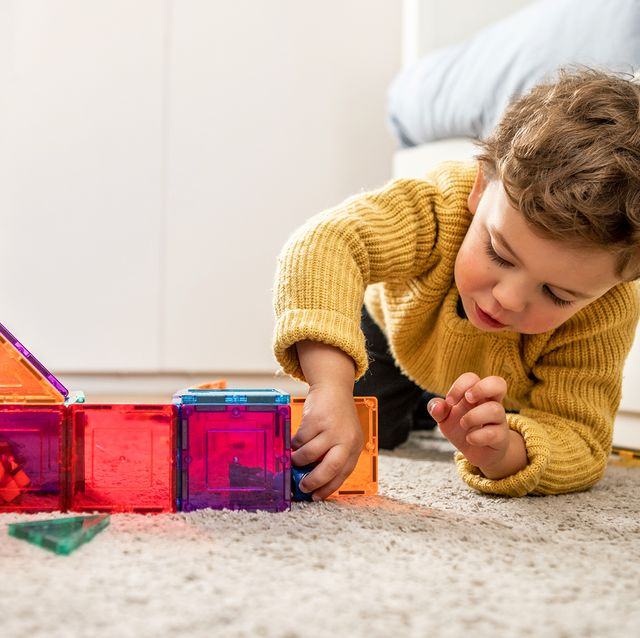 three year old boy playing with magnetic tiles