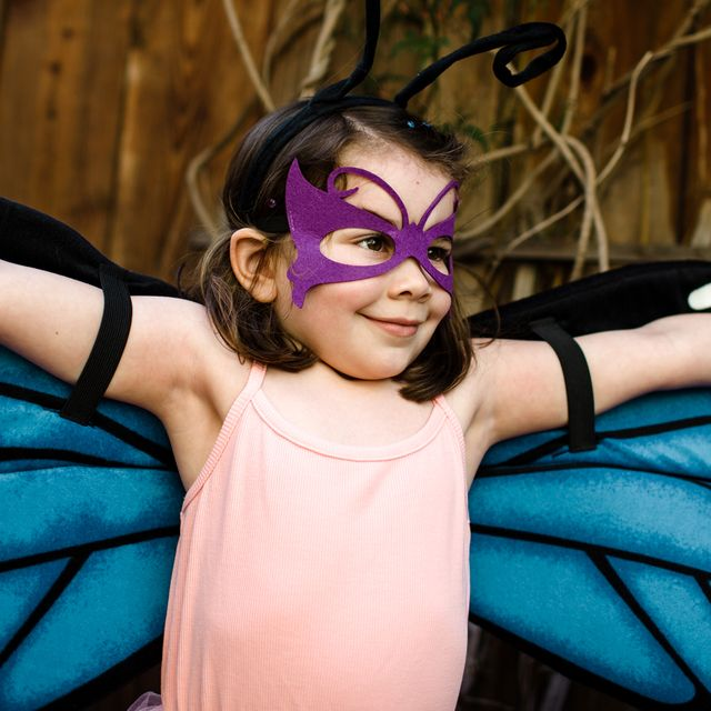 young girl in butterfly costume
