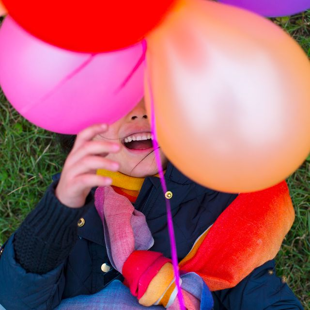 5 year old girl with balloons