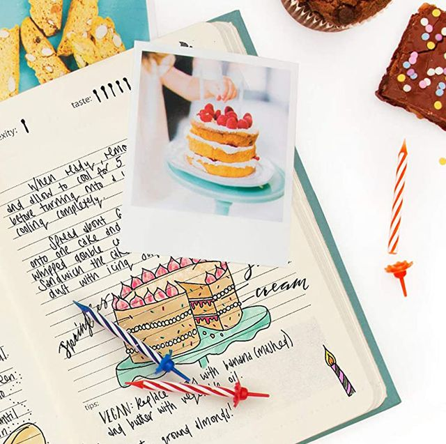 baking journal with candles, brownies andPolaroid of cake