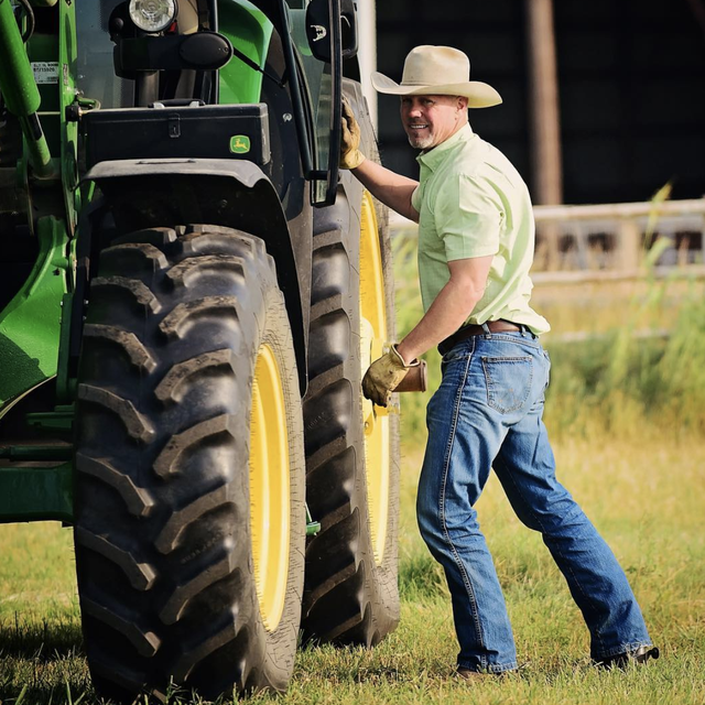 ladd drummond standing against tractor