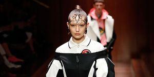 9e41a3584085 Gigi Hadid proves she s a street style superhero in caped Emilia ...