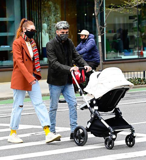 See Rare Photos of Gigi Hadid and Zayn Malik Walking Khai in NYC