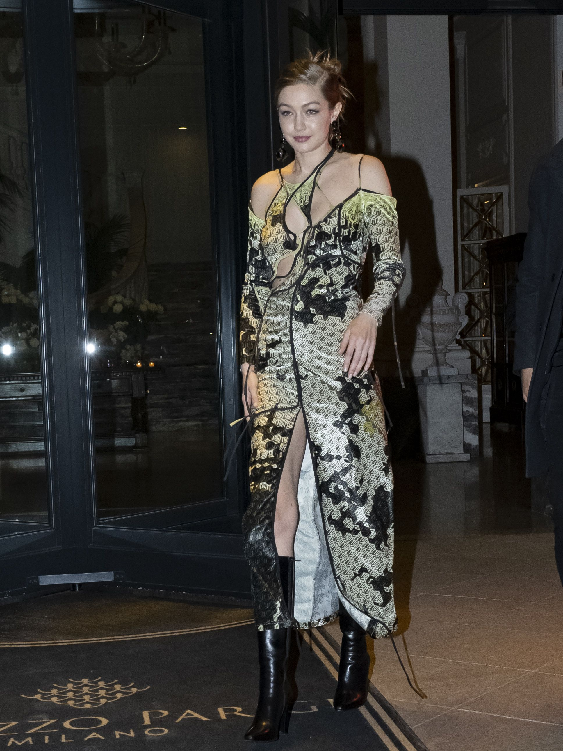 Gigi Hadid Wears An Ottolinger Gown With A Leg Slit In Milan