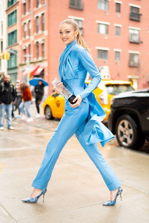 72c3fa86dca Gigi Hadid proves she's a street style superhero in caped Emilia ...