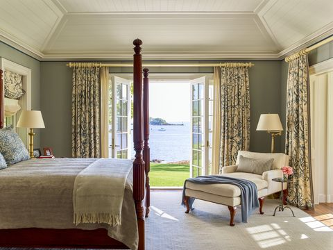 woodblock printed draperies frame the view in the owners bedroom