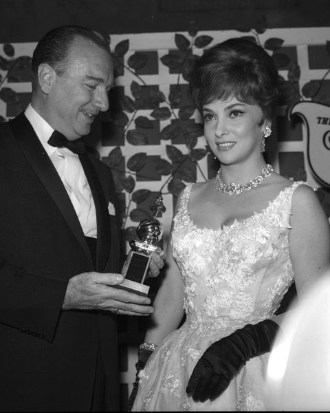 gina lollobrigida receives a golden globe award for come news photo